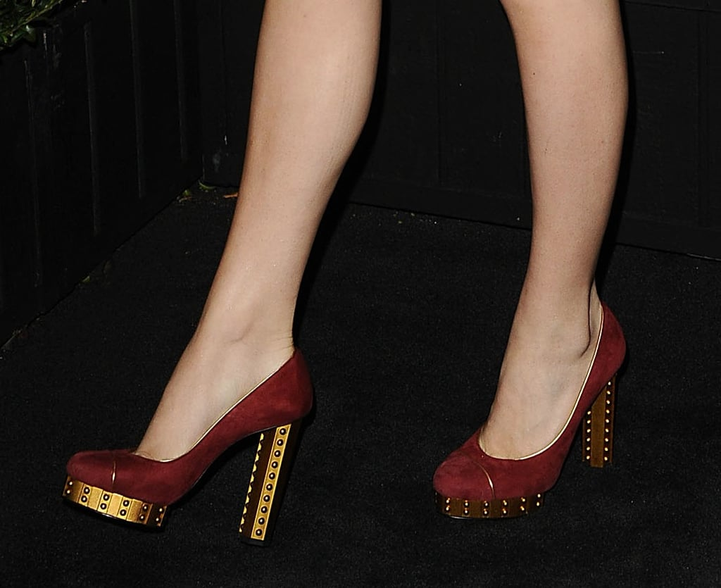 Chloë Moretz sported a cream tweed Chanel dress with maroon-and-gold Chanel pumps at the Chanel soiree.