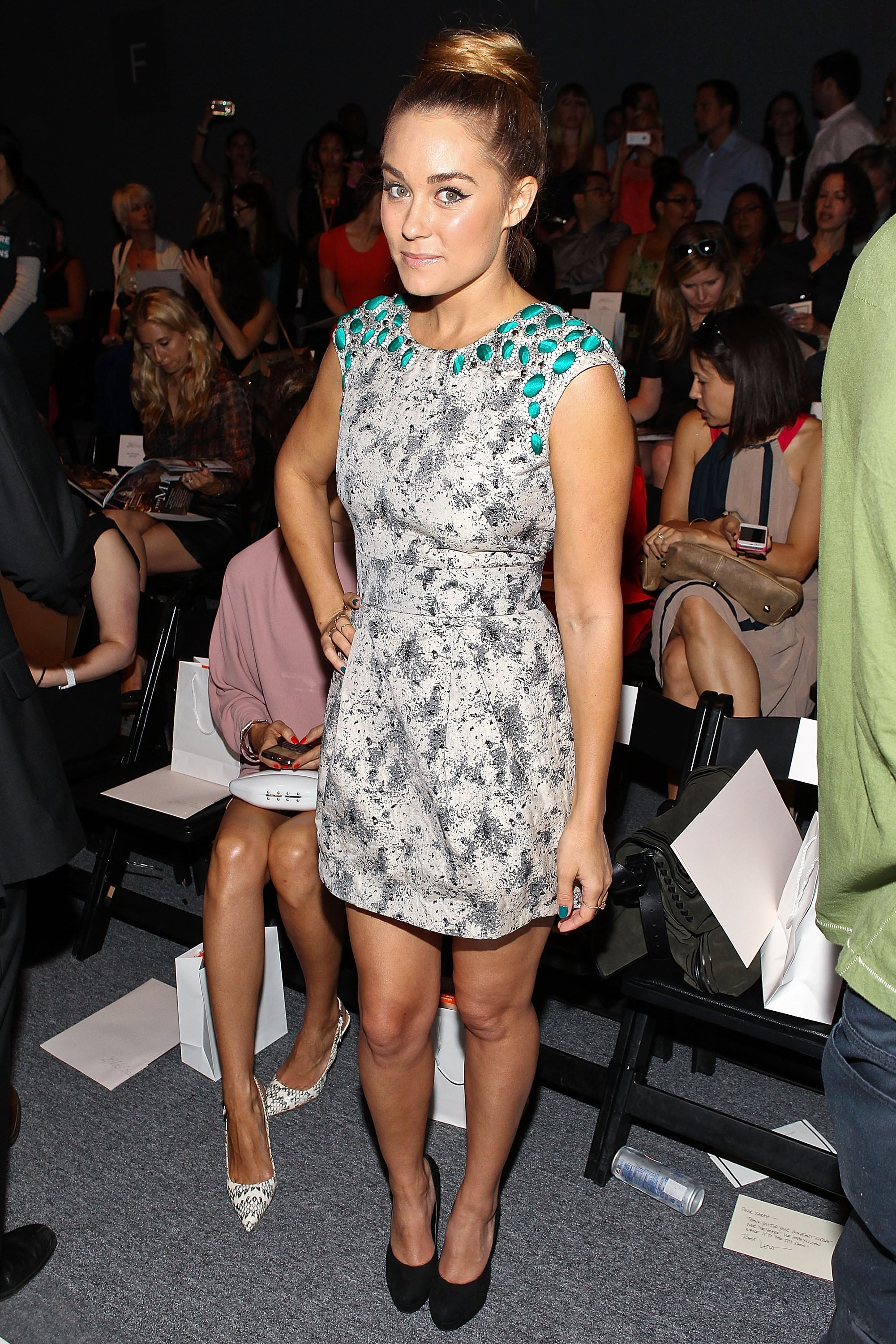 LC posed in a printed Lela Rose mini while sitting front row at the designer's show during New York Fashion Week in 2009. Lesson from Lauren: accentuate your dress's embellishments with coordinating nail polish.