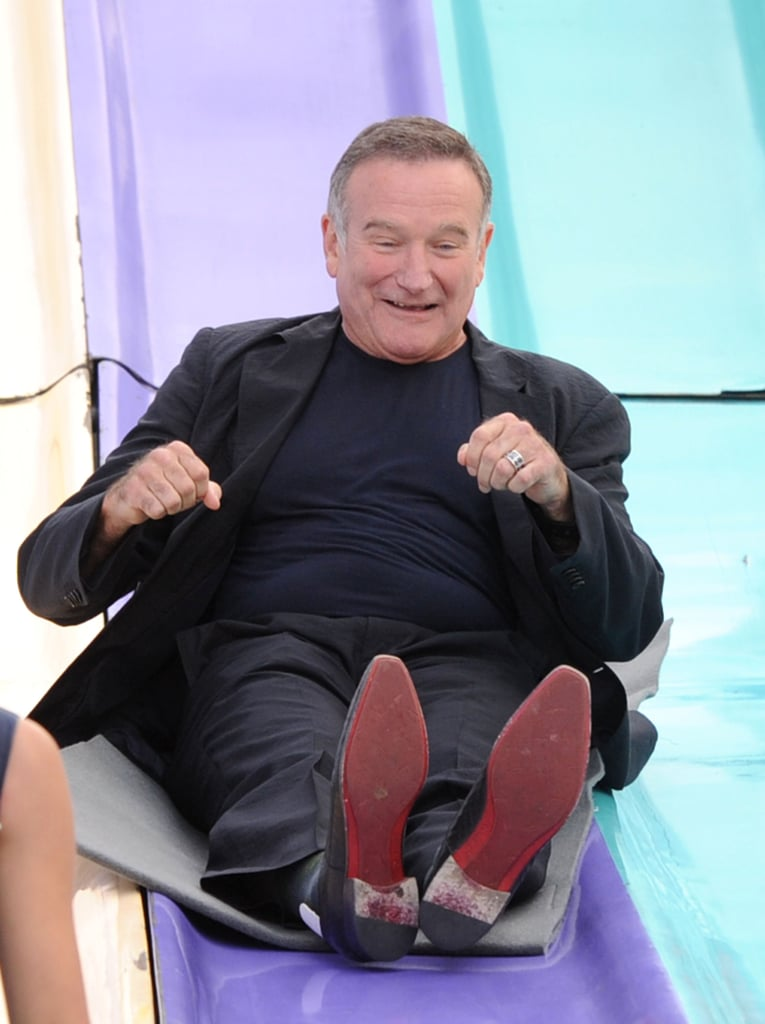 Robin got playful on a giant slide at the LA premiere of Happy Feet Two in November 2011.