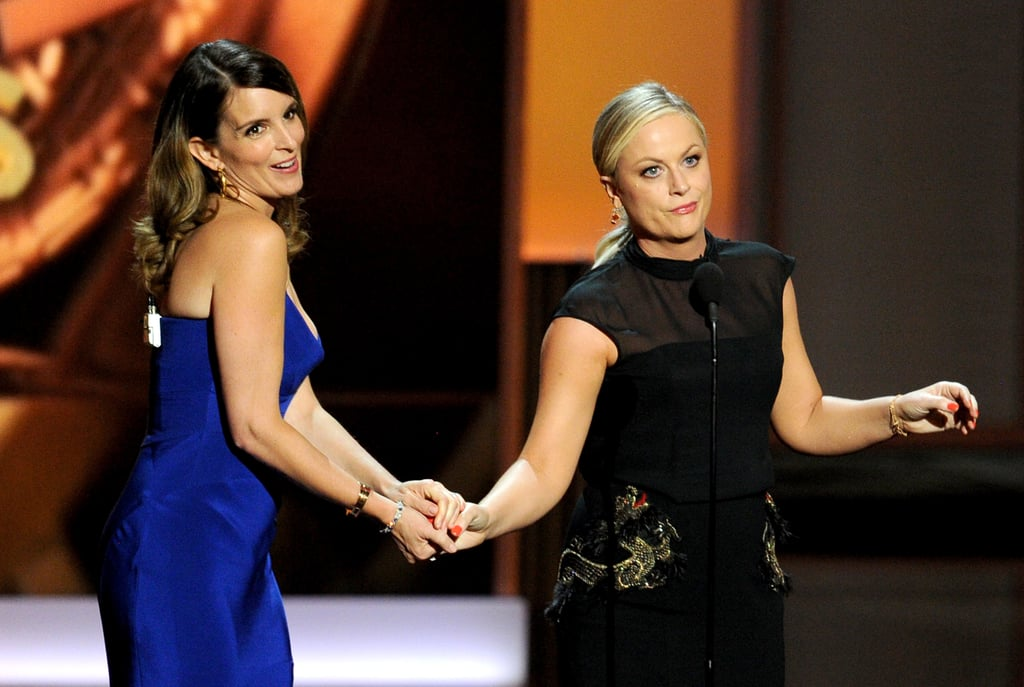 Tina Fey and Amy Poehler presented the first award of the night after putting down their popcorn.