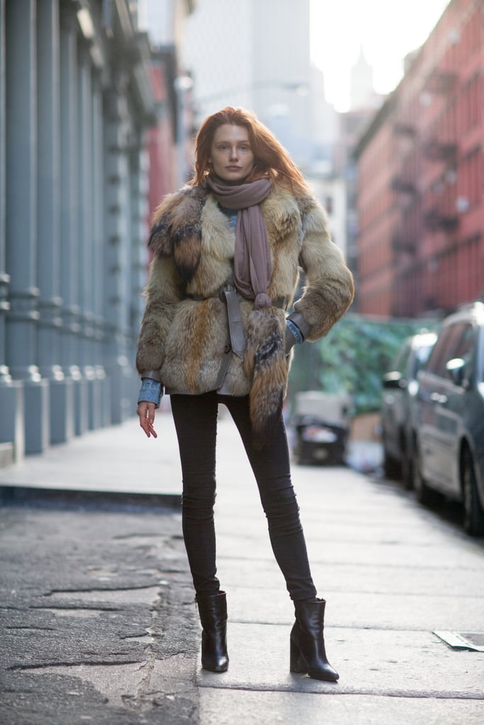 Borrow from a little model-off-duty style and add luxe with a furry topper — then elongate those stems with skinny black jeans and black booties. Source: Le 21ème | Adam Katz Sinding