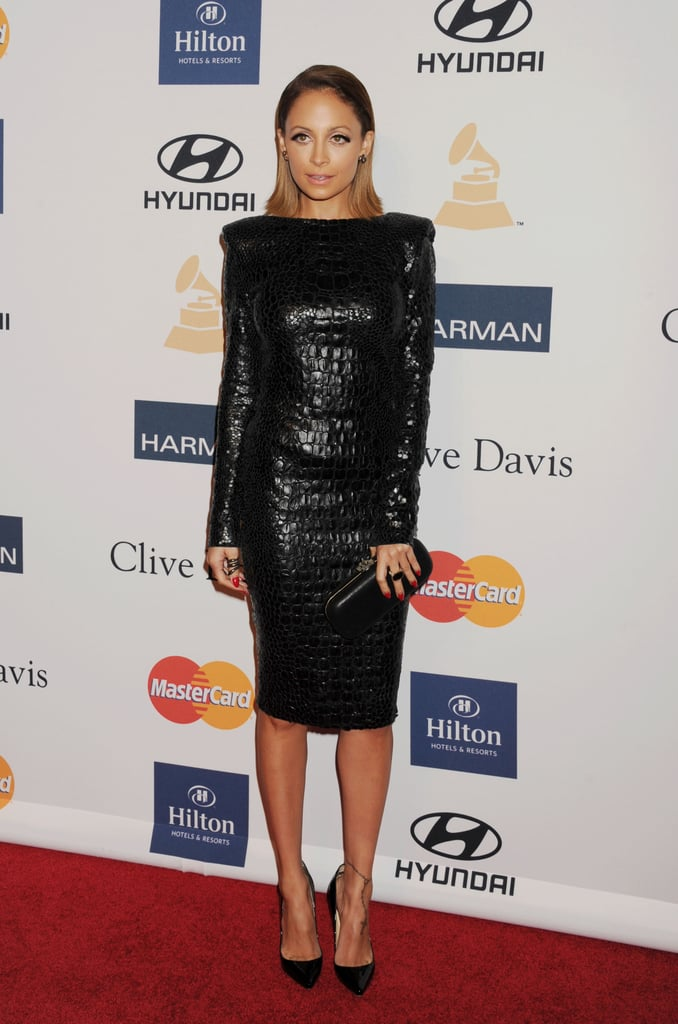 Nicole Richie showed her sexy side in Tom Ford's long-sleeved leather snakeskin dress and Christian Louboutin pumps. She paired the look with an equally cool slicked-back hairstyle.