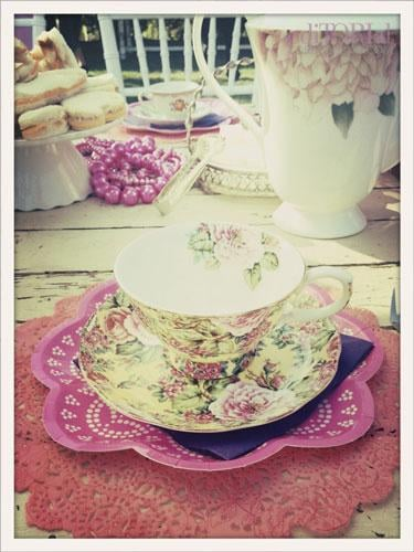 Mismatched teacups and saucers look fantastic and not so formal. Check your local Goodwill for them and make your own eclectic collection! We paired the china with adorable modern lace looking paper plates, and then instead of placemats, we spray painted white paper doilies in our party colors, like this one in pink.