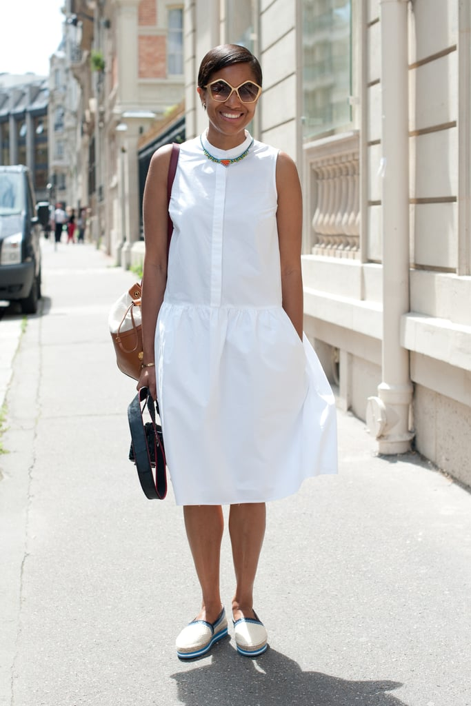 A feminine white sundress gets a dose of menswear-inspired cool via these loafer-like flats.