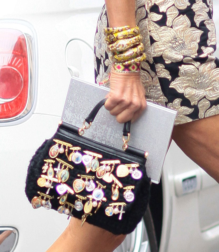 Anna Dello Russo toted this statement-making purse and an armful of gold bracelets. Source: Greg Kessler