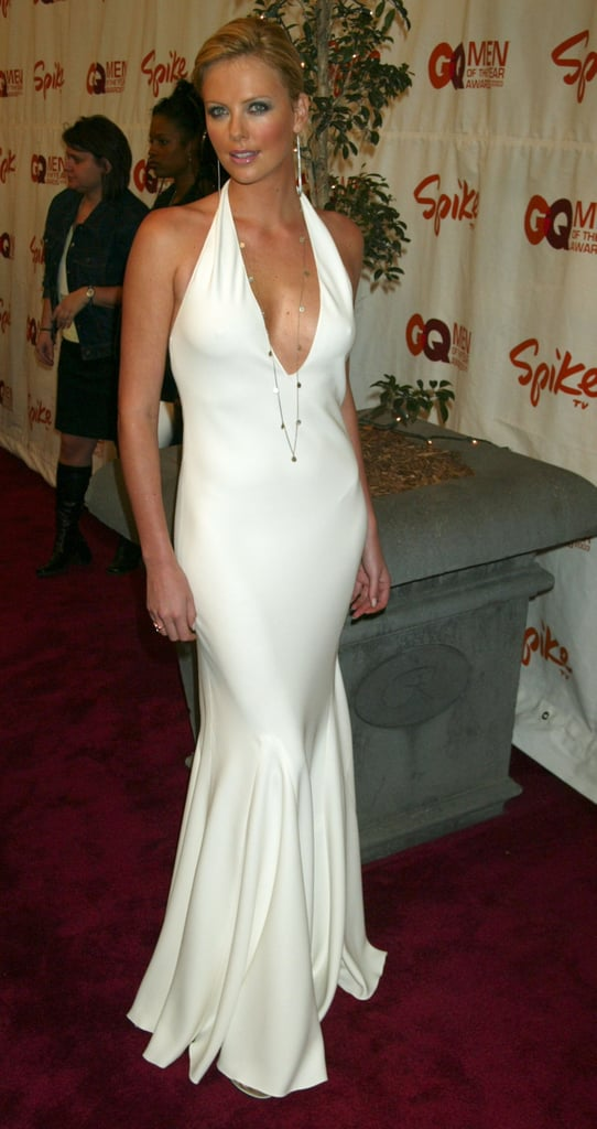Charlize Theron looked white hot in a cleavage-baring Ralph Lauren gown at the GQ Men of the Year Awards in October 2003.