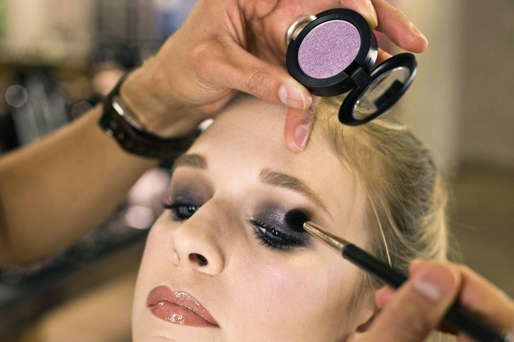 """For a little more dimension, hit the center of the lid with a touch of superfine shimmer. """"The trick is to tilt your head back so nothing falls off the eye while you're placing the pigment,"""" he says. This means you won't have to worry about cleaning up bits of eye makeup off your cheeks and under your eyes."""