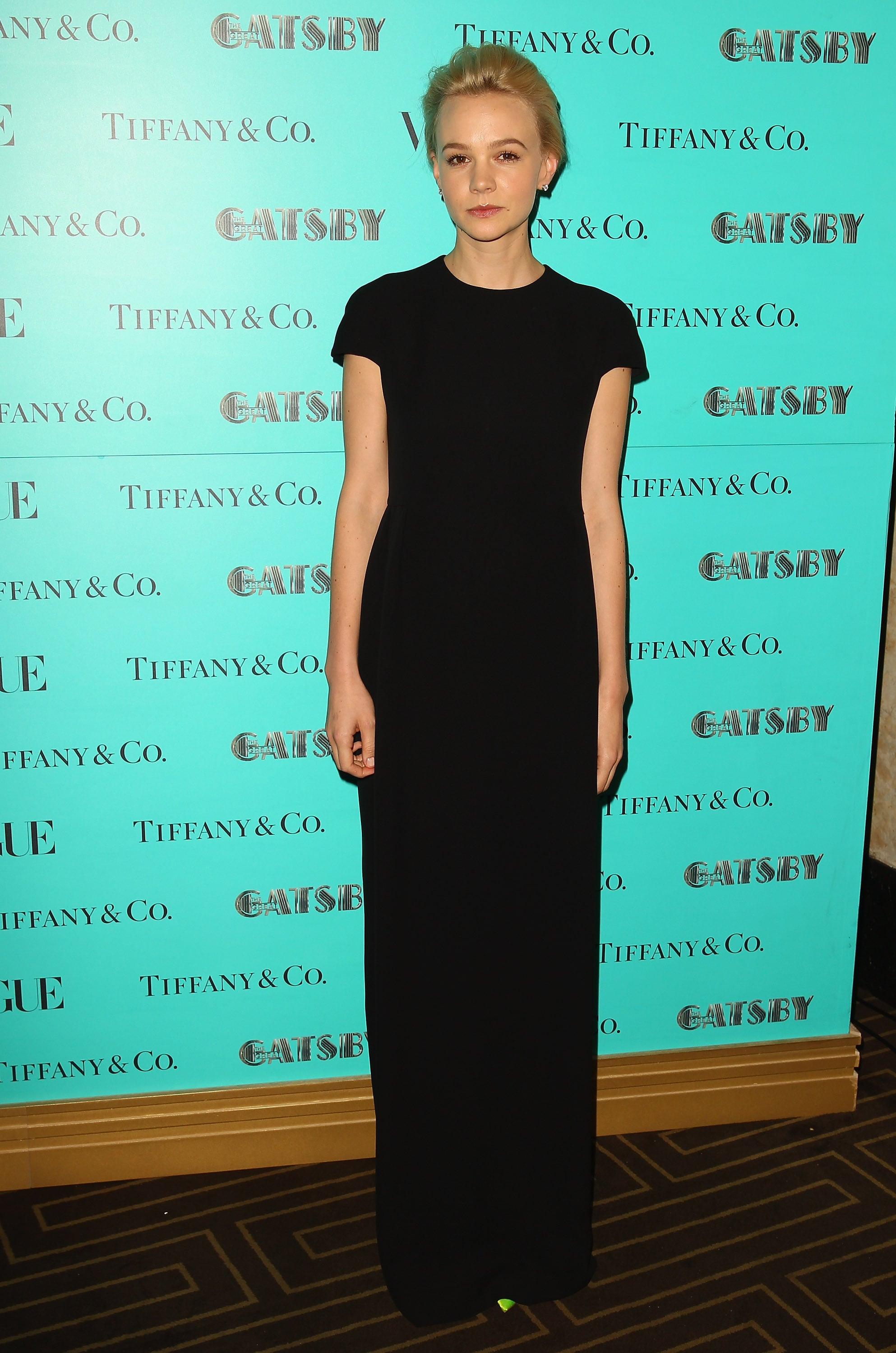 At a The Great Gatsby dinner hosted by Tiffany & Co. in Sydney, Carey was the epitome of minimalistic chic in a black short-sleeved Dior gown.