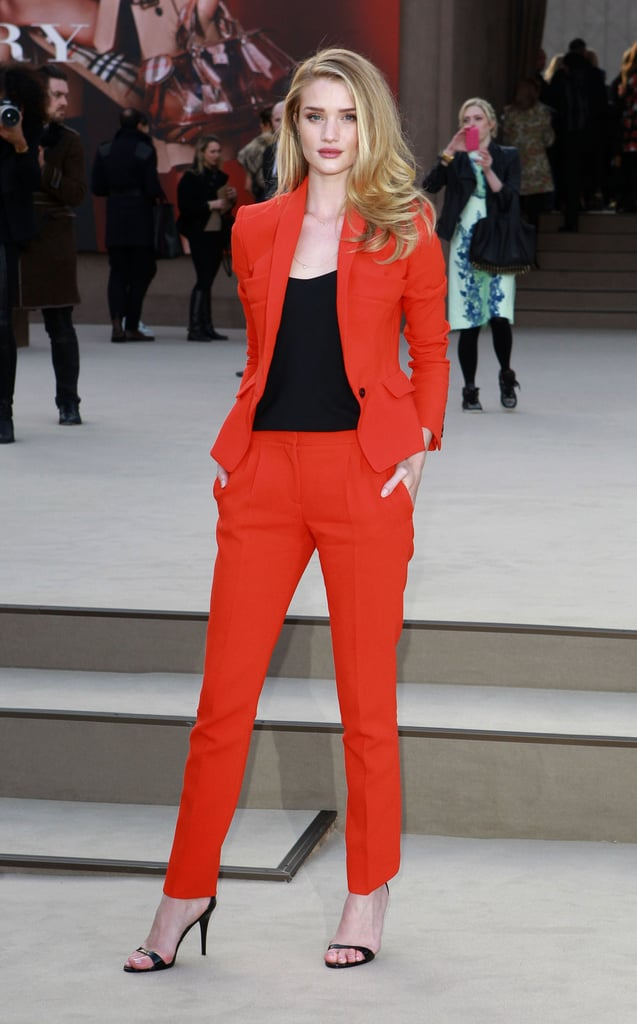 Rosie Huntington-Whiteley turned up the volume on her style in a bright red pantsuit, finished with a black tank and black ankle-strap sandals, at Burberry Prorsum.
