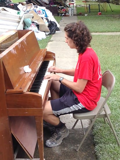 Teen's Outdoor Performance on Water-Damaged Piano Lifts Spirits After Louisiana Flood