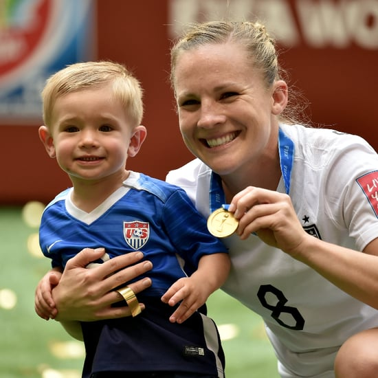 Amy Rodriguez and Son After World Cup Win