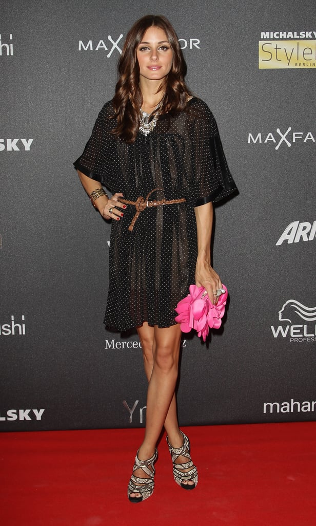 Olivia accented her Michalsky dress with statement-making accessories for an event in Berlin in 2010.