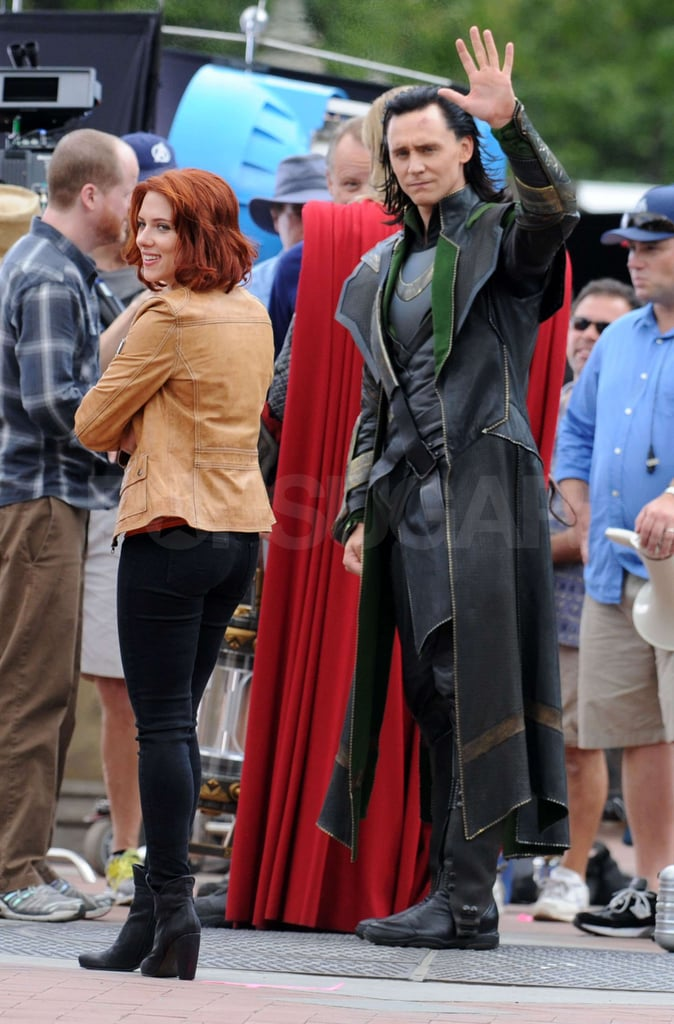 Tom Hiddleston waved to cameras as he shot with Scarlett Johansson.