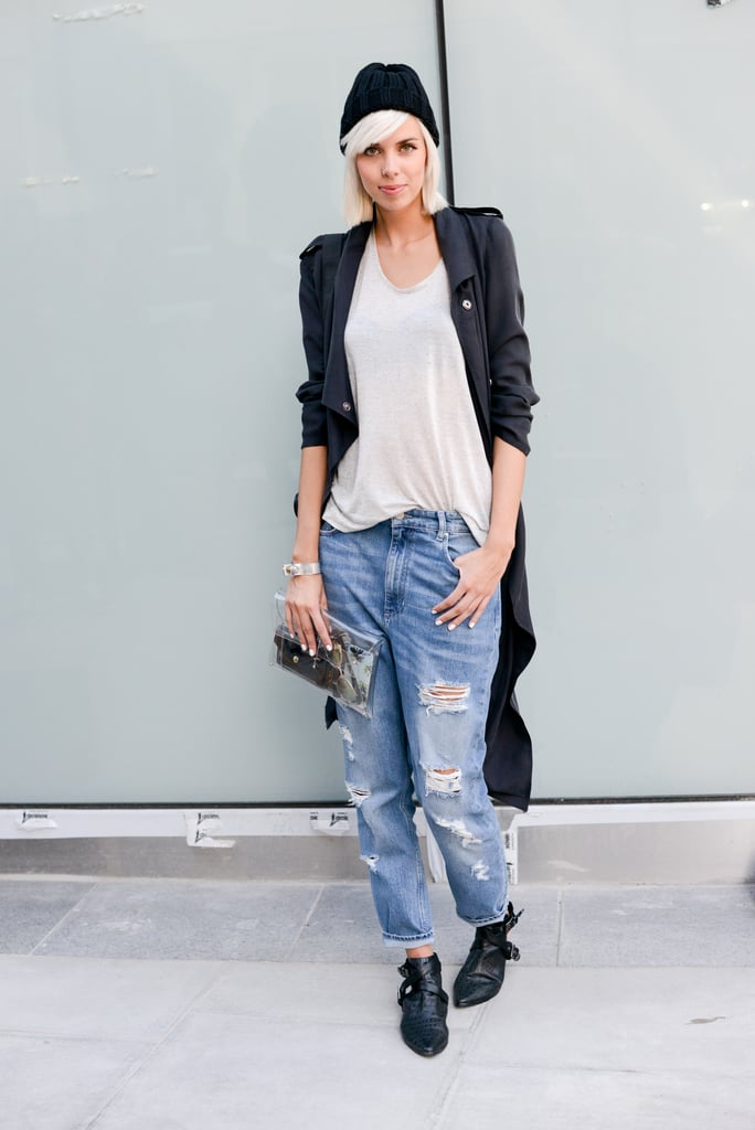 Ankle-cut boots, slouchy ripped jeans, and a long relaxed trench coat injected this outfit with a healthy dose of downtown edge.