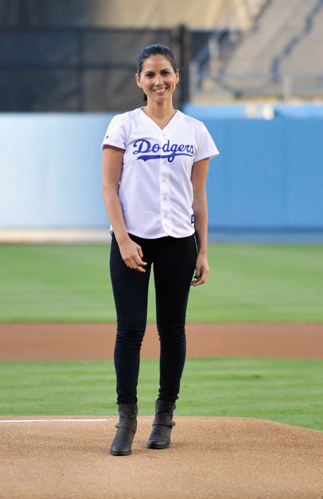 A classic jersey (albeit shrunken) was Olivia Munn's outfit of choice for throwing out the opening pitch at the LA Dodgers vs. Arizona Diamondbacks game.