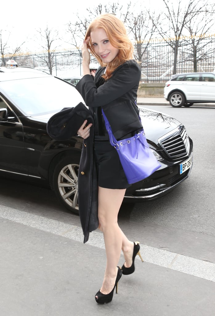 After the Louis Vuitton show, Jessica headed back to her hotel in a black Louis Vuitton ensemble. Her purple crossbody bag added much-needed color to her look.