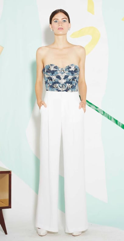 A sexy take on eveningwear: a beaded corset top with white wide-legged trousers. We can't get enough.