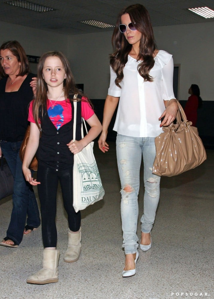 The actress chose Anoname distressed denim to break up her white-on-white look, ruffle-collar blouse and pointed pumps, for a June 2009 visit to London with her daughter, Lily.