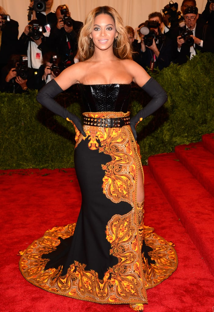 Beyoncé drew all eyes in her Givenchy look, which included a long flame-embroidered skirt with flame cutouts and matching thigh-high boots, python leather corset, and python belt with gold eyelets.