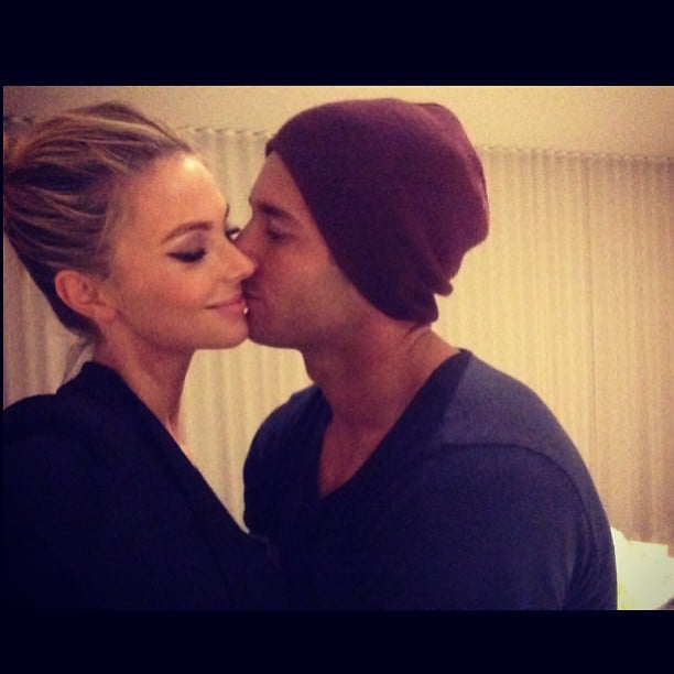 Stealing kisses! Jen and her husband Jake Wall got cosy in July 2013.