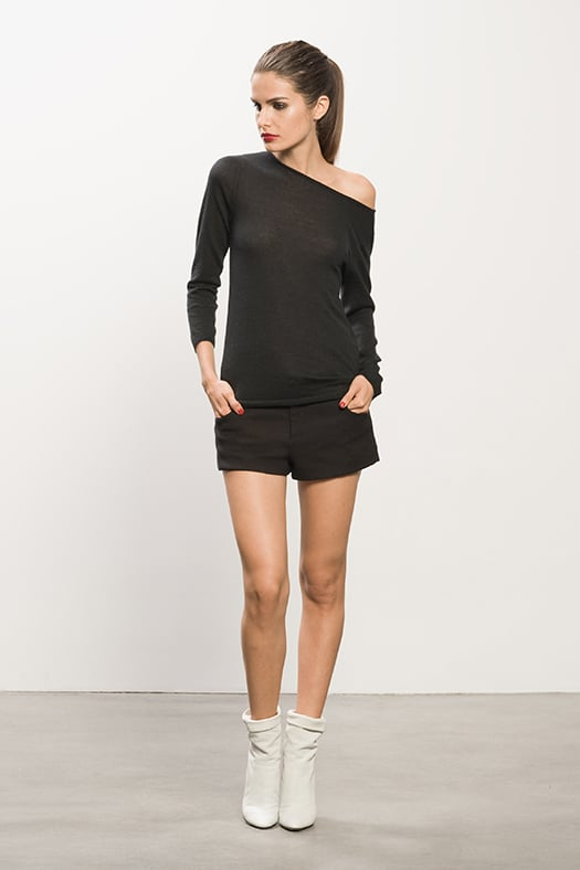 Cashmere Black Sheer Sweater ($395), Pique Black Shorts ($375), Rebel Off White Leather Boots ($895) Photo courtesy of Tamara Mellon