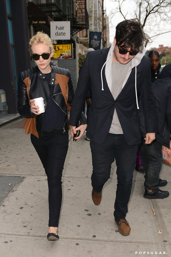 Carey Mulligan wore a black and brown leather jacket.