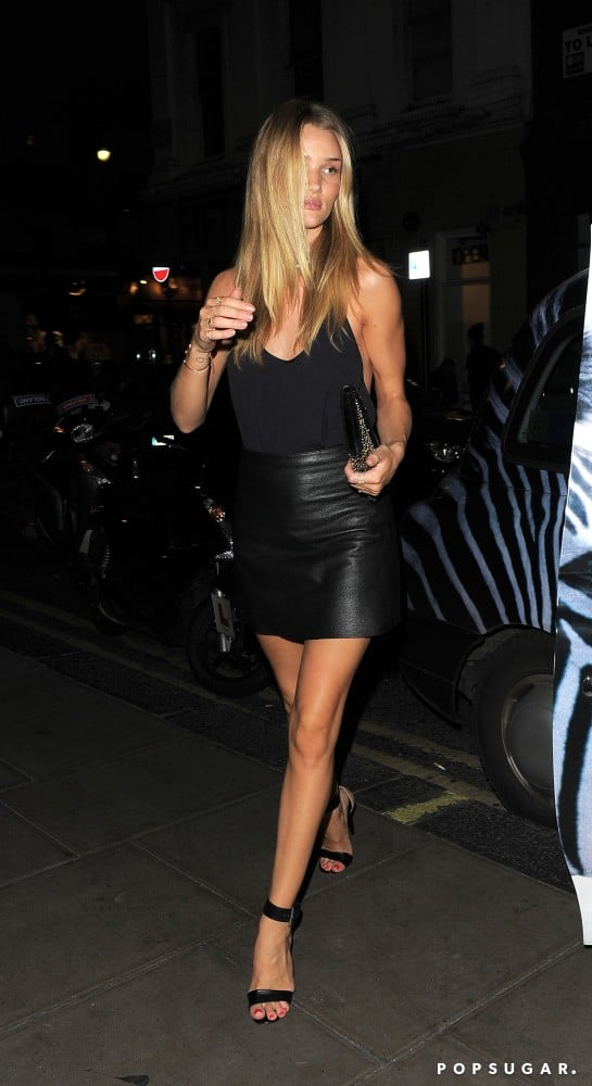 Rosie Huntington-Whitelely was minimalist chic and totally sexy in a slinky black tank, leather miniskirt, and ankle-strap heels for a night out.
