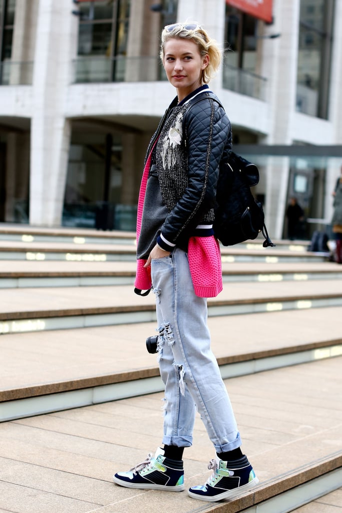 A quilted bomber, high-tops, and acid-washed denim had a '90s punk feel.