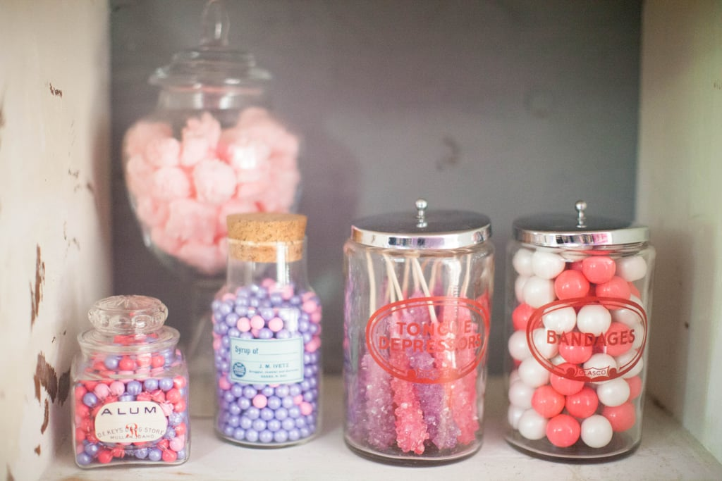 """Check out all of the fun candy options the kids had for the prescription bottles! """"We filled vintage medical glass canisters with pink and purple rock candy and rolled cotton candy 'cotton balls,'"""" Jenny said. """"Pink and purple candy filled apothecary jars."""" Source: Jenny Cookies"""
