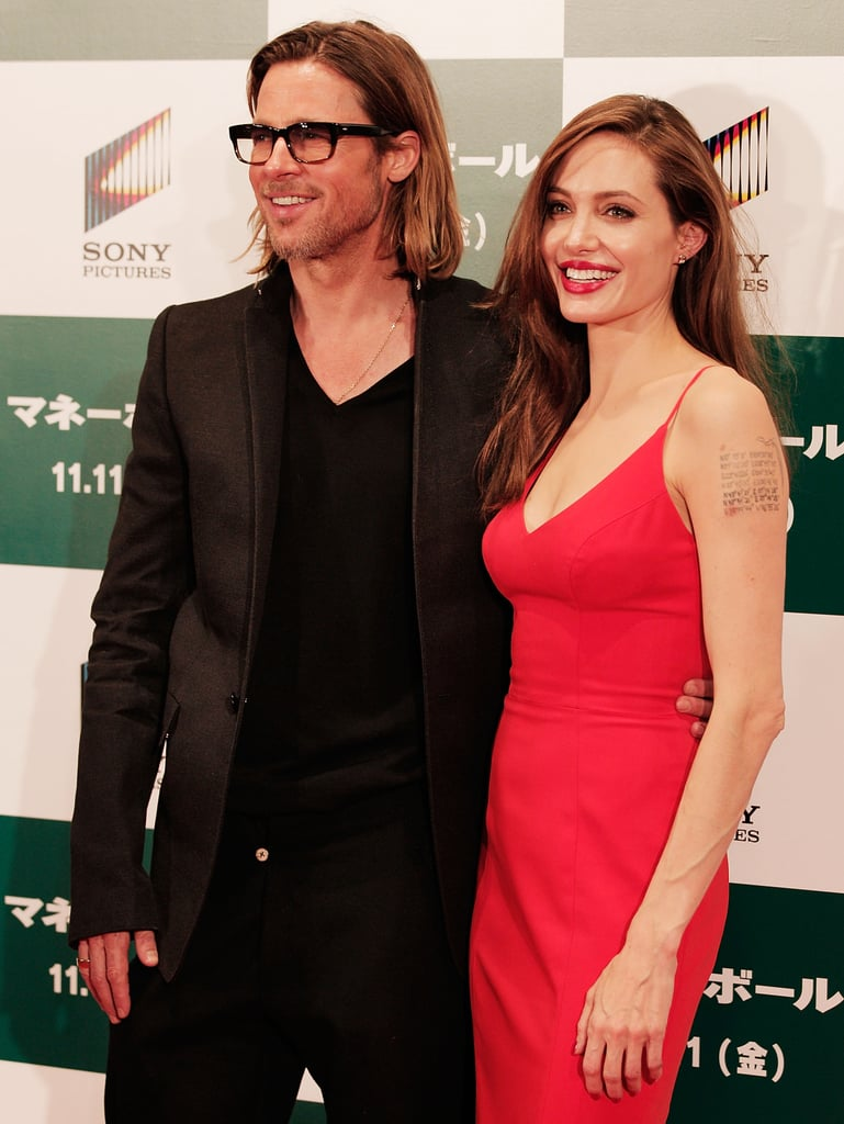 Brad Pitt and Angelina Jolie happily posed for Tokyo photographers at a Moneyball screening in November 2011.