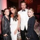 David and Victoria Beckham took a photo with Mary-Kate and Ashley Olsen.