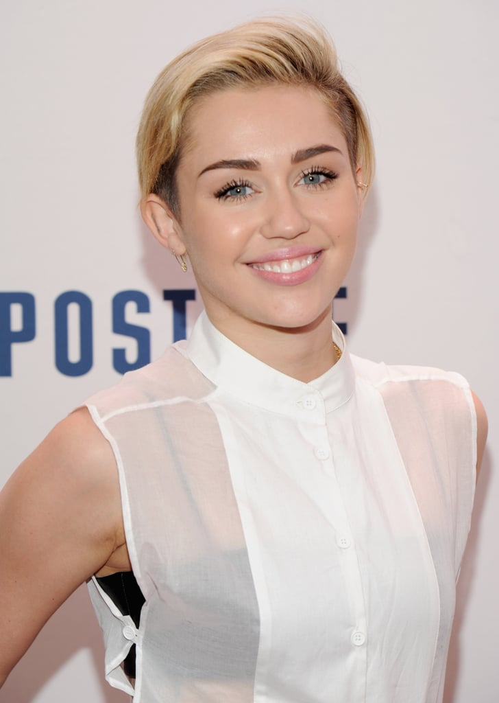 Miley Cyrus smiled for photos as she arrived for the event.