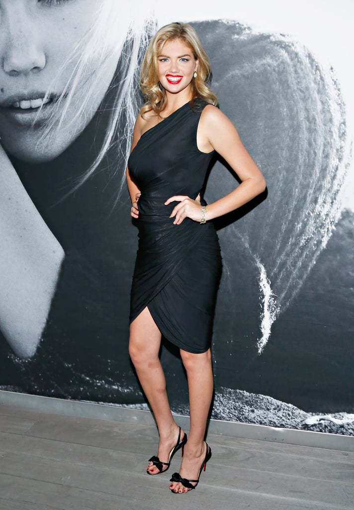 Kate Upton put her gorgeous body in a little black one-shoulder dress and bow sandals at a David Yurman rooftop soiree in NYC.