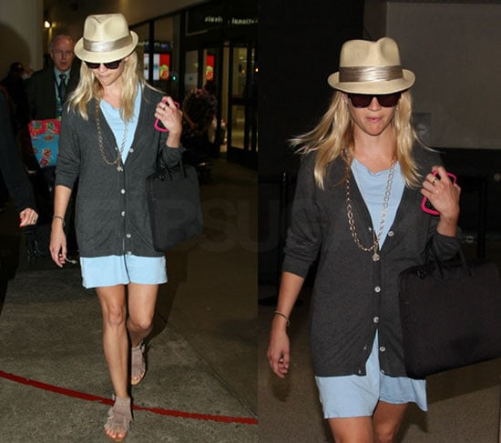 Reese Witherspoon in a Fedora and Blue Dress At LAX Flying Back From Italy