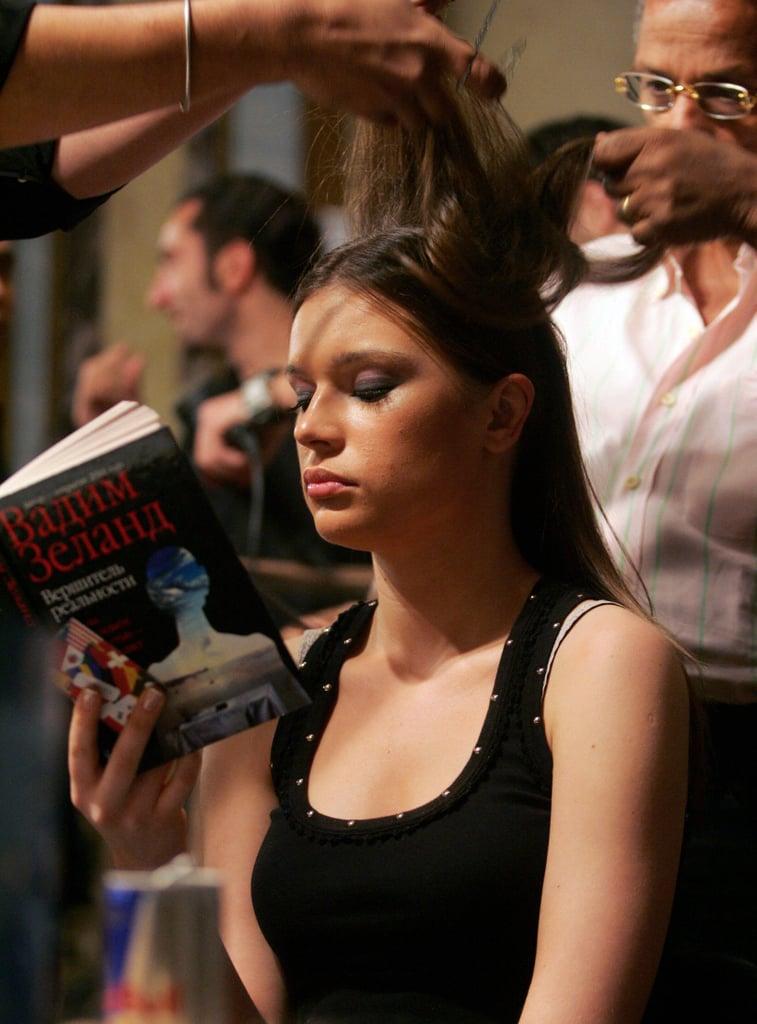 While getting her hair done for Saudi Arabian designer Hanan Madani's fashion show in 2006, a model read a book.