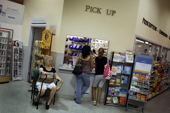 Customers Talk on Their Cell Phones While Getting Prescriptions Filled