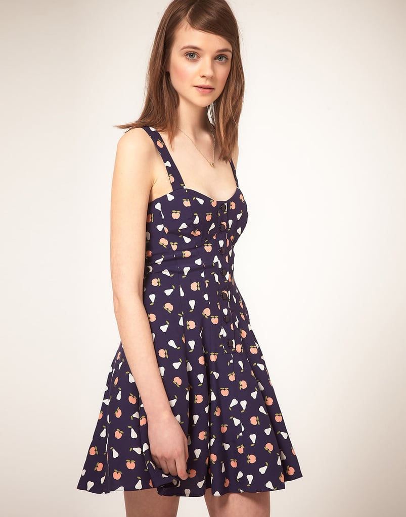 An adorable print and a feminine silhouette that we'd play up with a skinny belt and a pair of bright wedges.  Asos Summer Dress in Fruit Print ($45)