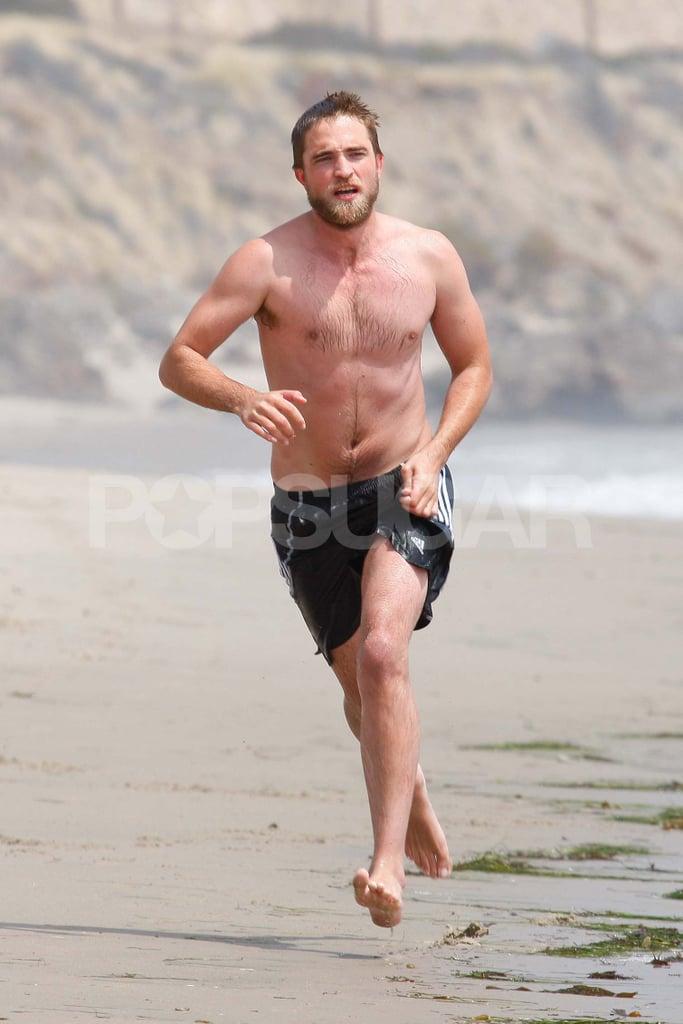 Robert Pattinson went running shirtless on the beach.
