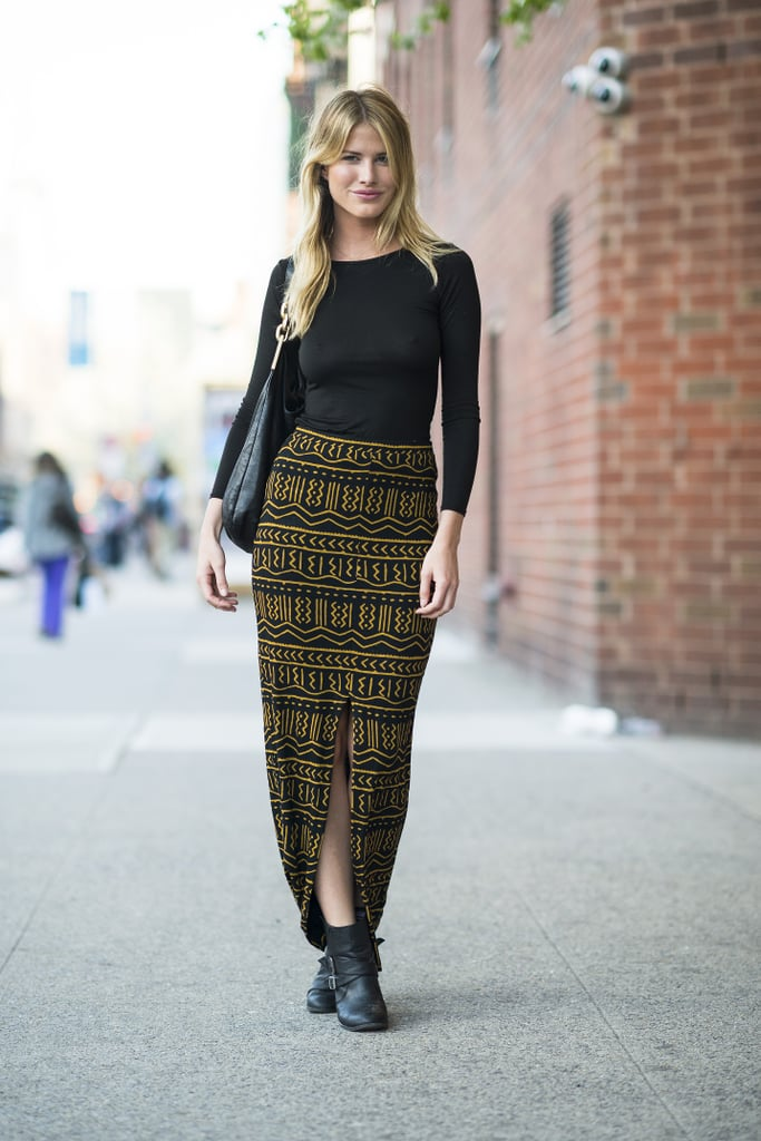 An Aztec-print maxi may be high-impact, but she smartly countered with a basic black tee for an easy on-the-go look. Source: Le 21ème | Adam Katz Sinding