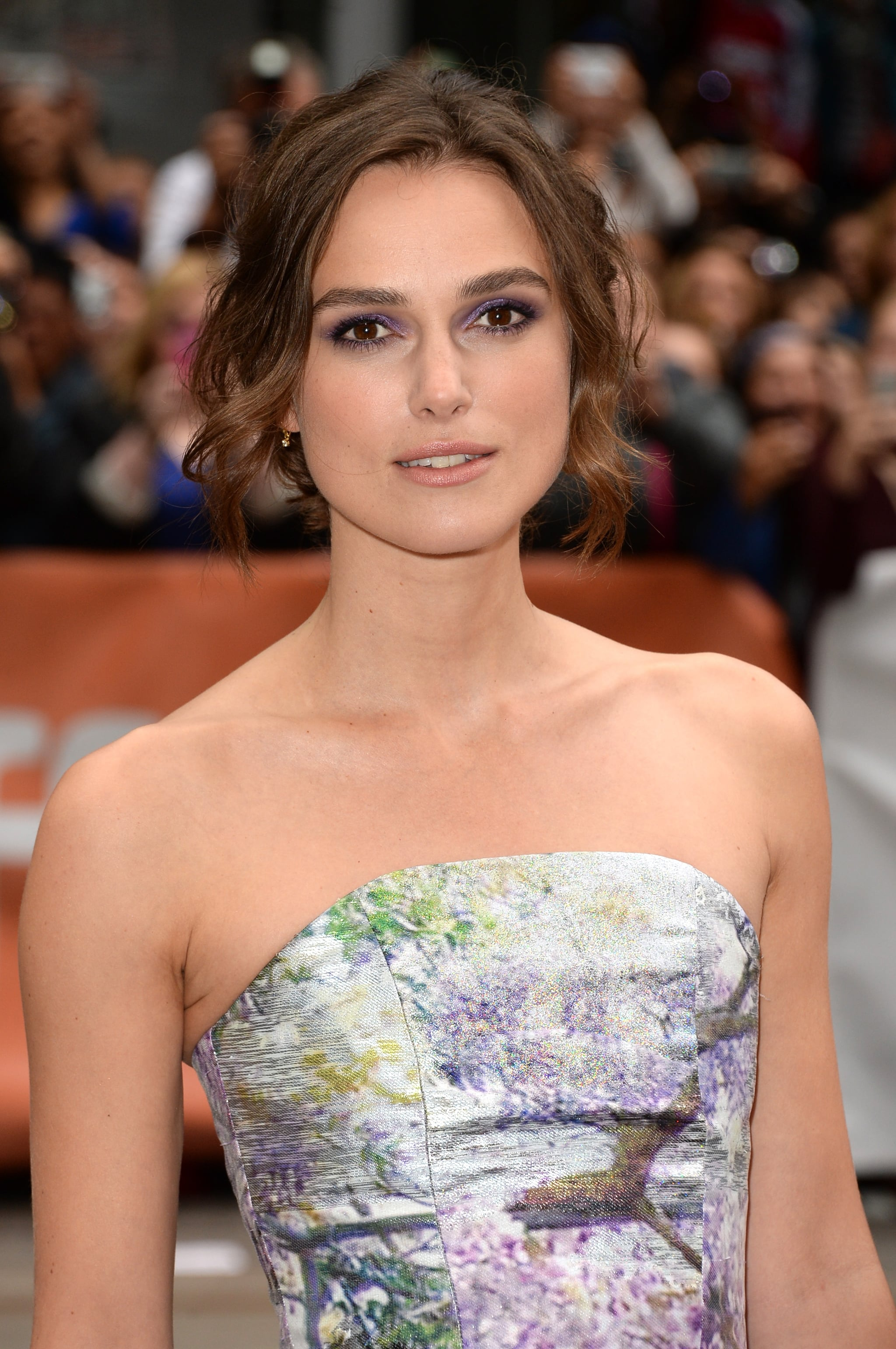 Keira Knightley chose a purple eye shadow to coordinate with her strapless frock at the Can a Song Save Your Life? premiere.