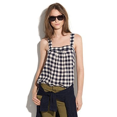 We adore the girly spin on these checks in a breezy-cut tank.   Madewell Checked Campground Tank ($58)