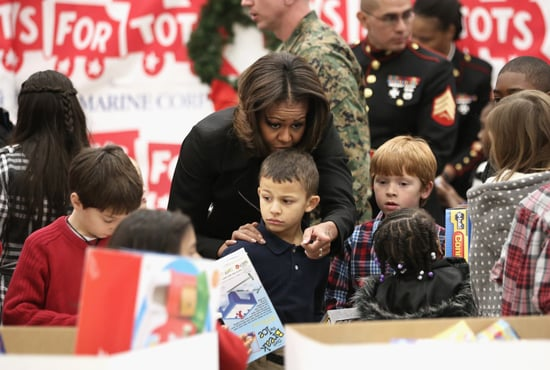Michelle-Obama-helped-children-find-gifts-Military-Corps-Toys