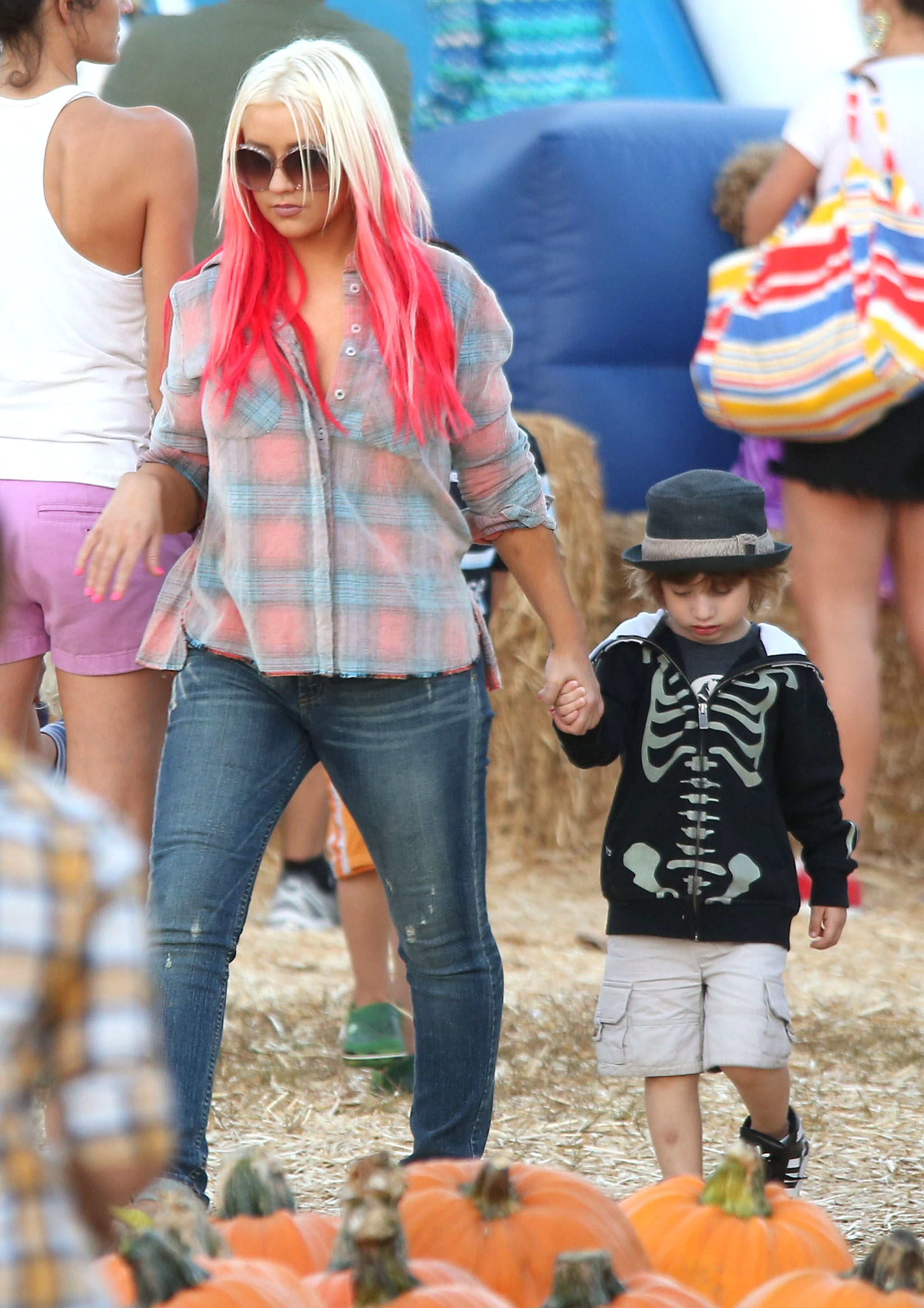 Christina Aguilera and her son, Max, held hands while they scoured the pumpkins at Mr. Bones Pumpkin Patch in LA.