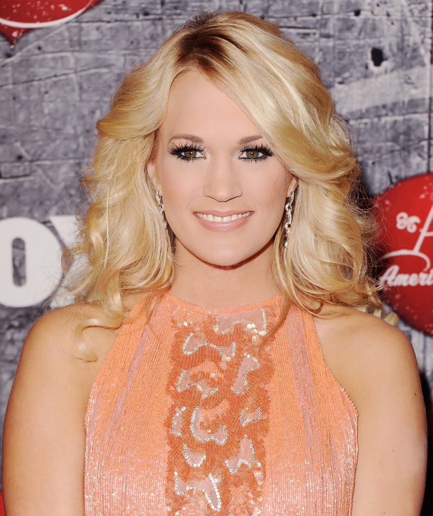 Carrie Underwood went for a tangerine frock at the American Country Awards.