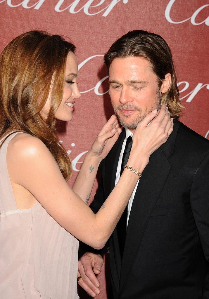 Angelina Jolie cozied close to Brad Pitt at the January 2010 Palm Springs Film Festival Awards.