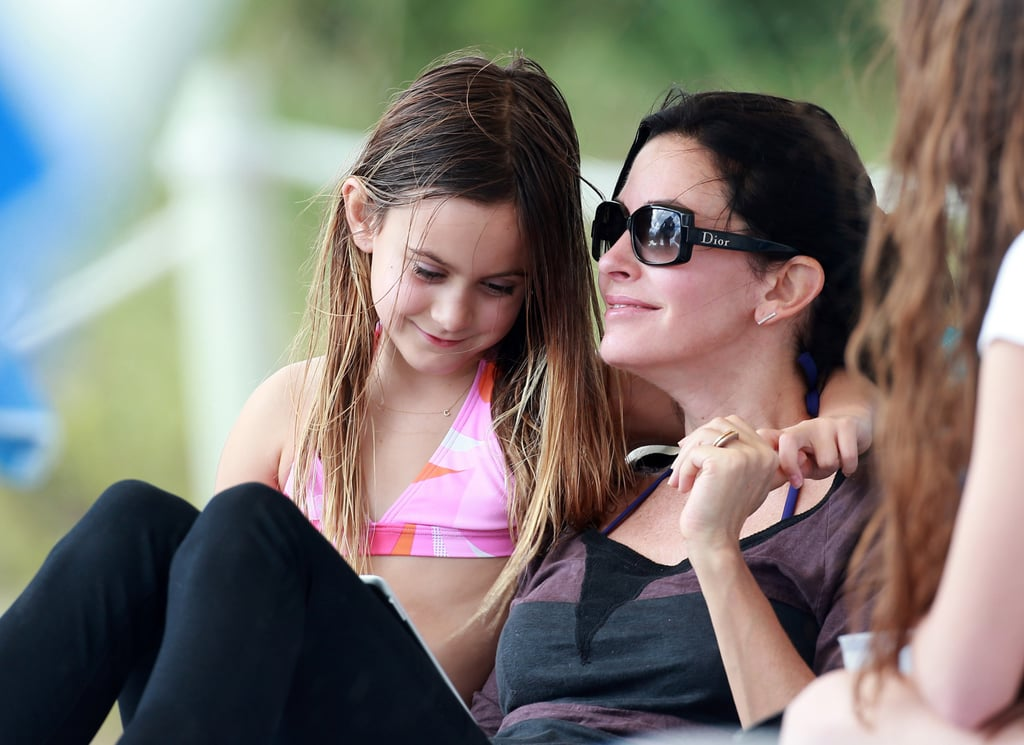 Courteney Cox lounged poolside with her daughter, Coco Arquette, in Miami.