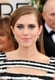Playing up the black and white theme, Allison Williams matched her textural gown with a silver and black beauty palette.