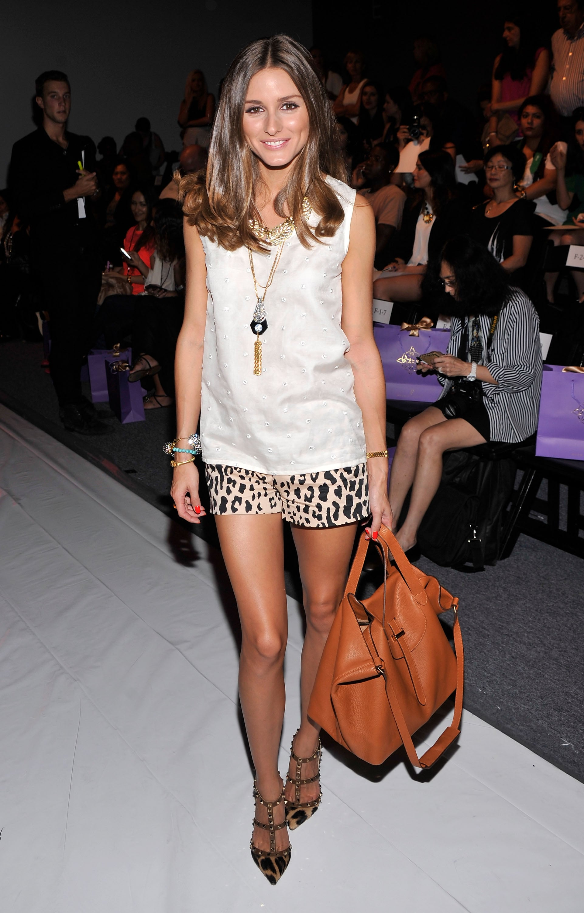 Olivia kicked off Fashion Week in NYC at Noon by Noor, sporting a cool, ladylike mix of embellishment and print. She outfitted a pair of leopard-print Tibi shorts with a Noon by Noor shell and finished it all off with Lulu Frost jewels, a Meli Melo bag, and studded Valentino heels.