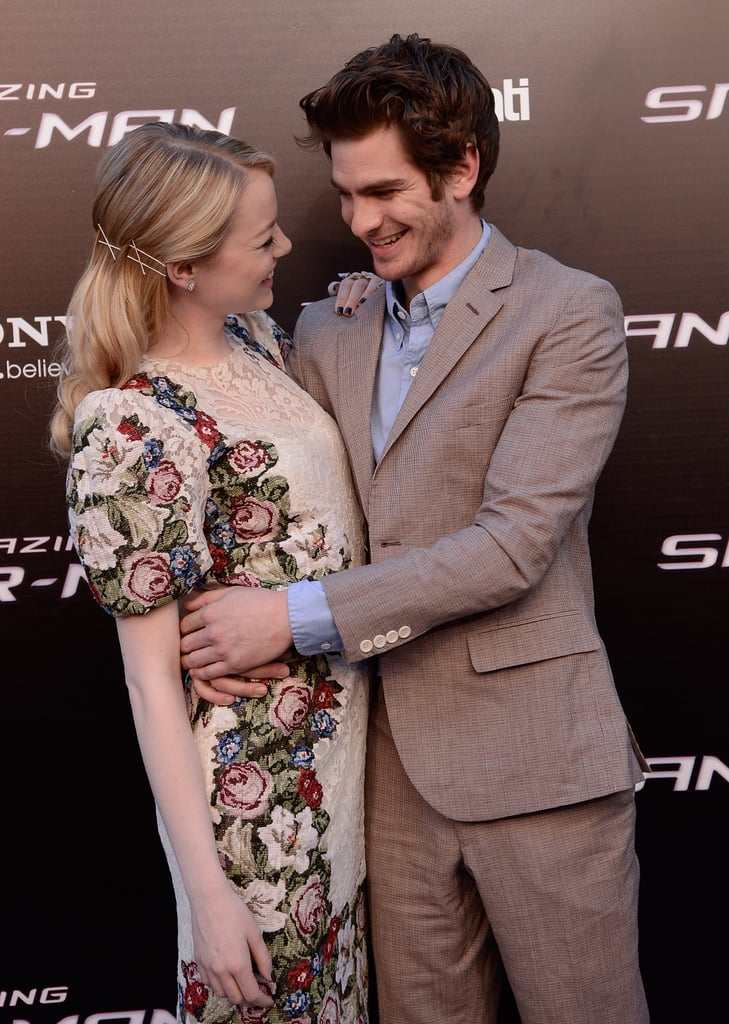Emma Stone looked lovingly at her boyfriend, Andrew Garfield, as he held her close during the Spanish premiere of The Amazing Spider-Man in June 2012.