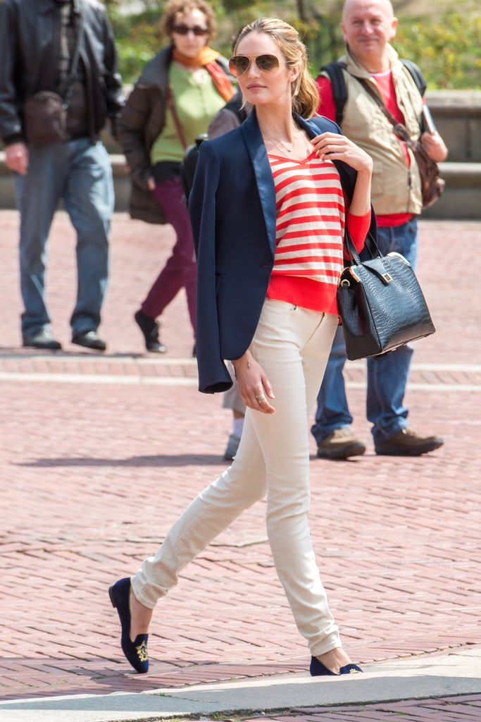 For a classic-chic feel, mimic Candice Swanepoel's ensemble by matching a red-and-white striped sweater with cream pants, a navy blazer, and matching navy loafers.